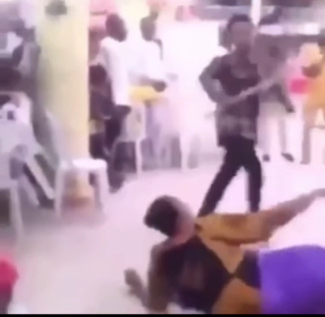 Check Out What This Pastor Was Spotted Doing To A Woman Even As She Begged Him To Stop (+Video)