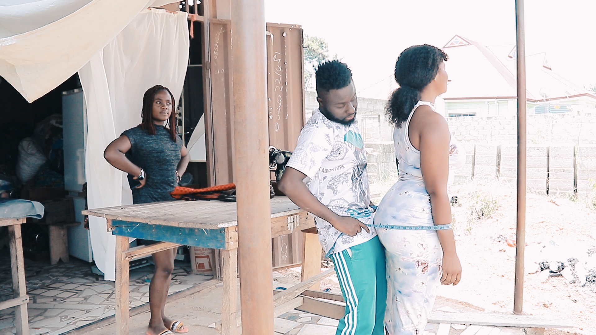 Video Of Male Tailor Caught On Camera Touching A Woman's Back$ide In Public [WATCH]